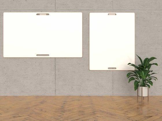 Design-Whiteboards an grauer Wand